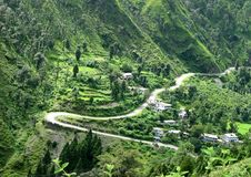 Picturesque winding road in Indian himalayan  foot. Scenic winding road  Near Nainital In Indian Himalayas Royalty Free Stock Images