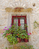 Picturesque window and flowerpots Royalty Free Stock Image