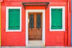 Picturesque windows with shutters of red house on the famous isl Stock Photography
