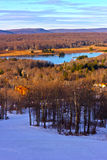 Picturesque wintry valley and lake. A view onto the West Virginia countryside from the top of a skiing mountain Royalty Free Stock Image