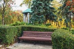 Romantic bench in autumn botanical garden Stock Images