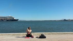 Picturing cruise ship. A tourist takes a picture of a cruise ship in Tagus river Stock Images
