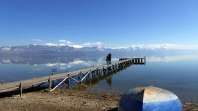 Picturing Lake Prespa, Macedonia. Picture of a Pier on a Lake Prespa, Macedonia, with couple picturing mountains Royalty Free Stock Photo