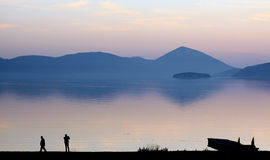 Picturing lake prespa in macedonia on sunset. Pisture of a men picturing lake prespa in macedonia on sunset Stock Photos
