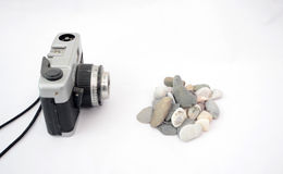 Picturing Pebbles. Picture of a camera picturing pebble stones in a studio Royalty Free Stock Images