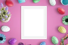 Picure frame mockup on pink desk. Easter decorations beside. Flat lay Royalty Free Stock Photos