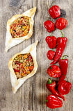 Pide, also known as Pita in some countries. Is a dish similar to pizza, typically served as a part of Turkish, Armenian and Middle-Eastern cuisines Stock Image