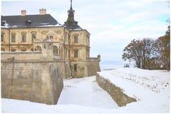 Pidhirtsi slott på en vinterdag Fotografering för Bildbyråer