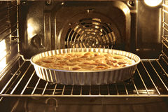 Pie. Apple pie in an oven Royalty Free Stock Photo