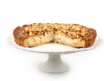 Pie with almonds. Filled with cream and quince with honey and cinnamon on a white stand Royalty Free Stock Photos