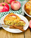 Pie with apples on plate and board Royalty Free Stock Photos