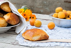 Pie with apricot on knitted napkin. Ruddy tasty pie on the scapula handmade napkin on background apricot Royalty Free Stock Photo
