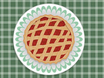 Pie. Berry pie on the plate and on the green tablecloth Royalty Free Stock Photography