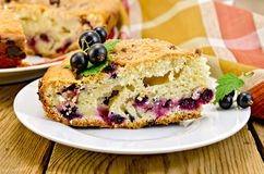 Pie with black currant on board with napkin Stock Image