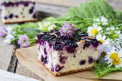 Pie with blueberries on wooden table Royalty Free Stock Images