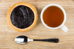 Pie with blueberry jam, cup of tea and teaspoon Royalty Free Stock Photography