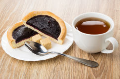 Pie with blueberry jam, sugar in plate, teaspoon and tea Royalty Free Stock Photography