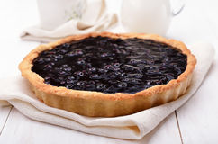 Pie with blueberry jam. On white wooden table, shallow depth of field Stock Photo