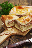 Pie with cabbage and sausages Royalty Free Stock Photos