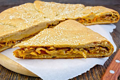 Pie with cabbage and sesame on board Stock Photography