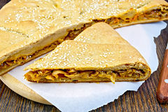 Pie with cabbage and sesame on paper Royalty Free Stock Image