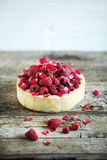 Pie cake with fresh raspberries, rosewater and rose petals Stock Photos