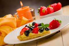 Pie with candle and strawberries Royalty Free Stock Photo