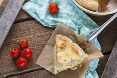 Pie with cauliflower, zucchini and cheese. Rustic pie with cauliflower, zucchini and cheese Royalty Free Stock Photos