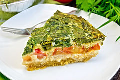 Pie celtic with spinach on table Royalty Free Stock Photos