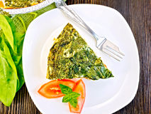 Pie celtic with spinach and tomato in plate on table top Stock Image