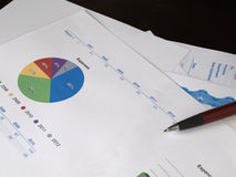 Pie Chart in a pile of documents.  Royalty Free Stock Photo