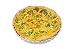 Pie with cheese and herbs. In baking form Stock Photos