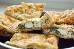 Pie with cheese and sesame seeds. Chunks of cake cheese with sesame seeds and herbs Stock Photography