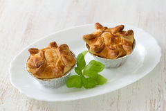 Pie with chicken with basil on white plate Stock Photos