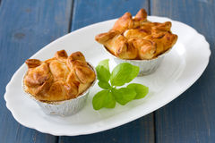 Pie with chicken with basil on white plate Stock Photo