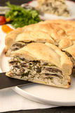 Pie with chicken and mushroom. Closeup of a slice from a russian pie with chicken and mushroom - kurnik Stock Images