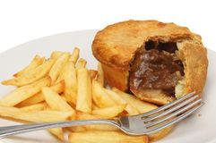 Pie and chips closeup. Closeup of a steak pie and chips with a fork stock photography