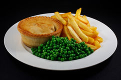 Pie and chips with peas. A traditional British Bar Dish Stock Image