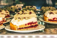 Pie with cranberries and cream laid out for sale in a cafe royalty free stock photo