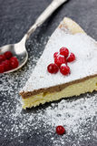 Pie with a cranberry and icing sugar. On a dark board Royalty Free Stock Image