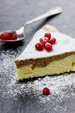 Pie with a cranberry and icing sugar. On a dark board Royalty Free Stock Photography