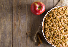 Pie with crumble on plank background. Apple crumble. Apple pie with crumble on wooden background. A delicious piece of cake royalty free stock photography