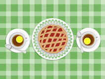 Pie and cups of tea. Strawberry cake and two cups of tea with lemon in the background tablecloths Royalty Free Stock Photo