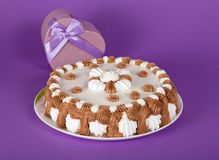 Pie on dish and gift heart Stock Images