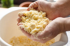 Pie dough. A baker holding a mixed pie dough crumble in her hands Royalty Free Stock Photos