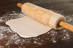 Pie dough and rolling pin. Stock Photo