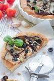 Pie with eggplants, olives and pine nuts Stock Image