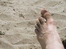 Pie en la arena Fotos de archivo libres de regalías