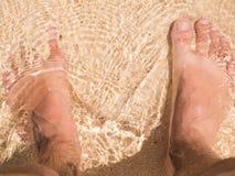 Pie en la playa Fotos de archivo