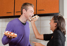 Pie fight in the kitchen Stock Image